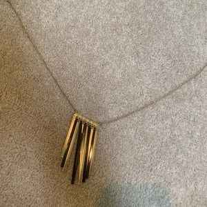 gold and black hanging necklace
